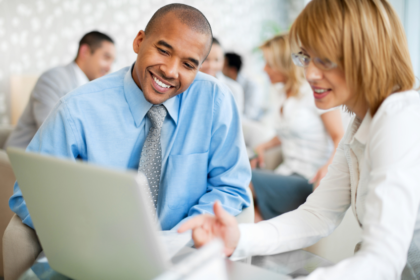 Two businesspeople working together on a laptop. The focus is on the African-American man. Group of businesspeople in the background. [url=http://www.istockphoto.com/search/lightbox/9786622][img]http://dl.dropbox.com/u/40117171/business.jpg[/img][/url] [url=http://www.istockphoto.com/search/lightbox/9786738][img]http://dl.dropbox.com/u/40117171/group.jpg[/img][/url]