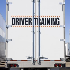Driver training sign on back of truck